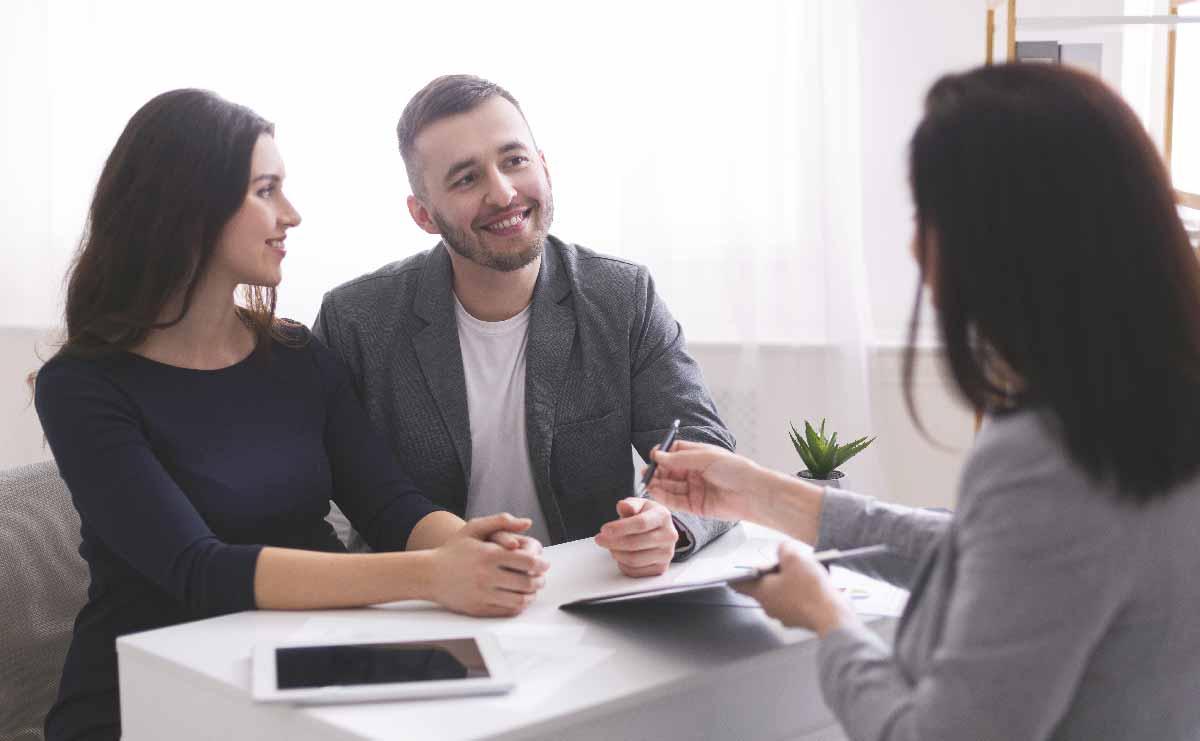 young-family-listening-to-financial-advisor-ready-DG6REN2.jpg